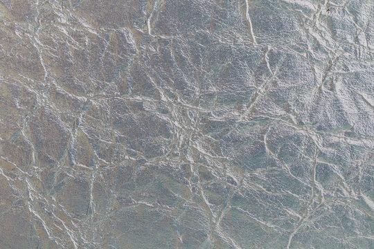 Textura metalizada con grietas y arrugas