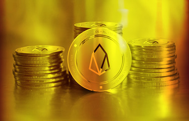 Eos digital crypto currency. Stack of golden coins. Cyber money.
