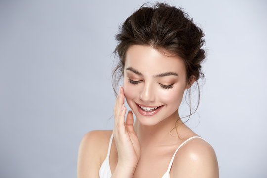 cute girl with natural make-up smiling and looking down