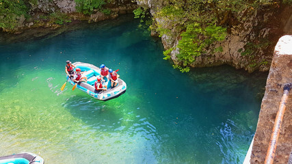rafting boats and athletes in  river Voidomatis just before begin the voyage greece