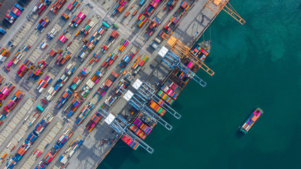 Photo Blinds Rotterdam Aerial view cargo ship terminal, Unloading crane of cargo ship terminal, Aerial view industrial port with containers and container ship.