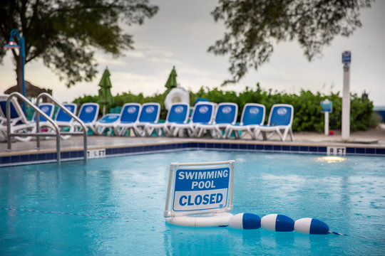 Swimming pool closed sign during thunderstorm in St.Pete's beach