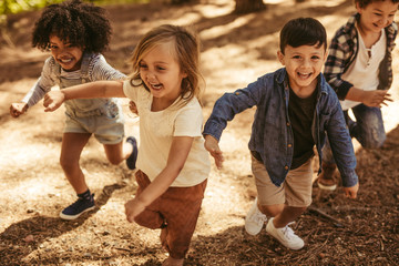 Children playing together in forest
