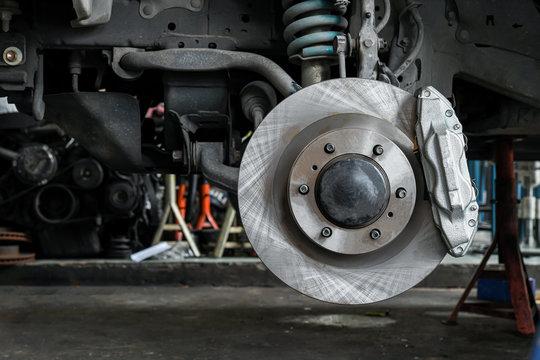 New car brake system replacement, brake disc, brake caliper.