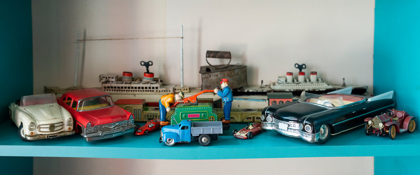 Old vintage toys on shelf.