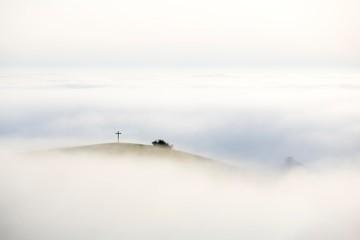 Foggy view of Bisberg with summit cross, Hegau, Baden-W¸rttemberg, Germany, Europe