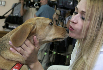 Isabella Aguilar and her dog Campeon (Champion) attend the trial of the dog's former owner in the first Costa Rica trial against the alleged animal abuser, in Atenas