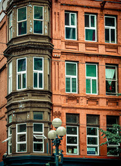 Fototapete - Bay Windows on Red Brick Apartment Building