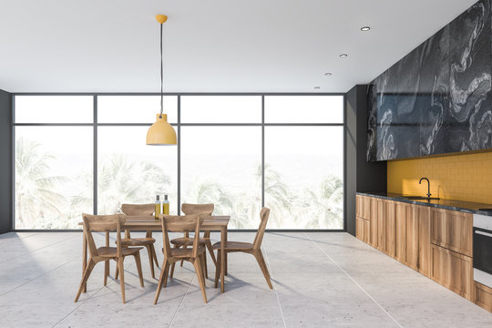 Yellow and black marble kitchen with table