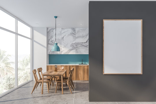 White marble and blue kitchen with poster