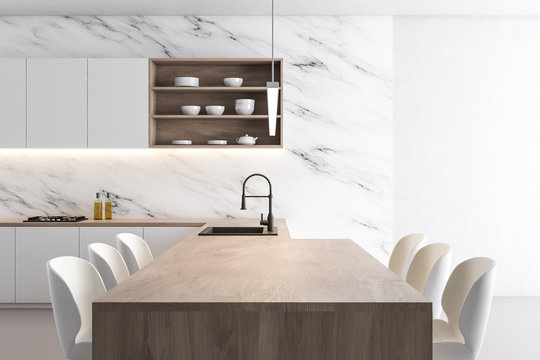 White marble kitchen with wooden island