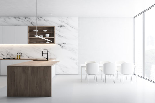 White marble kitchen, island and table