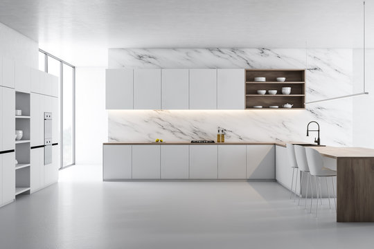 White marble kitchen, white counters and island