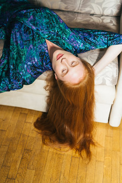 Stylish Ginger Woman Lying On The Couch.