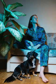 Elegant Woman With Her Dog On Blueish Lights.