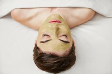 Woman having a facial at day spa