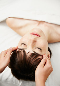 Woman receiving a facial at spa