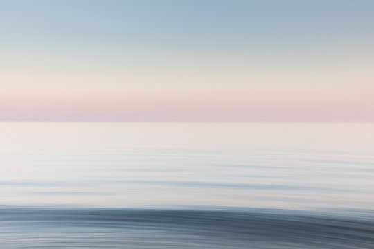 A soft blue and pink blurred seascape