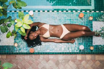Woman lying down in a bikini