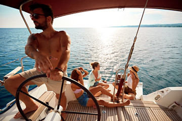 friend's having party on sailing boat at vacation .