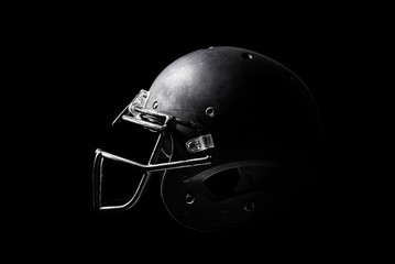 Football helmet on black background.