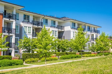 Luxury apartment building with green lawn in front Fototapete