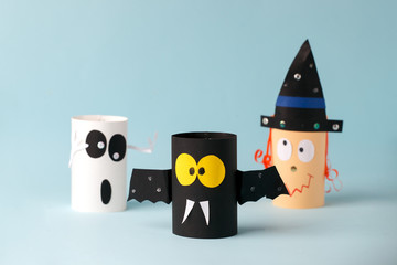 Halloween toy collection ghost, bat, witch on blue for Halloween concept background. Paper crafts, DIY. Handcraft creative idea fron toilet tube, recycle concept