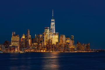Fotomurales - Banner of Lower Manhattan which is a apart of New york cityscape river side which can see One world trade center at twilight time, USA, Taking from New Jersey