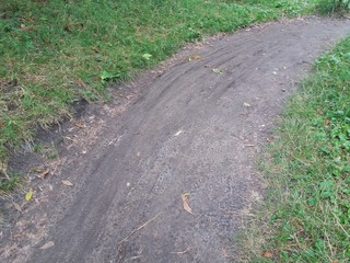 taking pictures of dirt road, bike tracks on wet ground