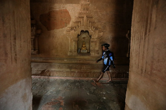 A biker tours the inside of an ancient pagoda, to celebrate Bagan being named as a UNESCO World Heritage Site in Bagan