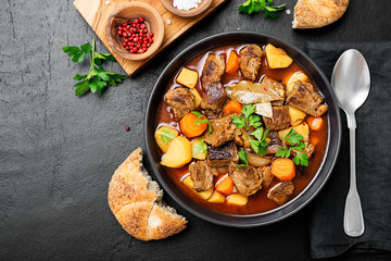 Beef meat stewed with potatoes, carrots and spices (hungarian goulash).
