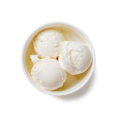 Bowl of vanilla ice cream isolated on white background.