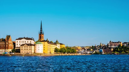 Wall Mural - Stockholm, Sweden. Time-lapse of Gamla Stan in Stockholm, Sweden with landmarks like Riddarholm Church during the sunny summer day. View of old buildings