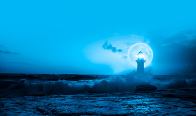 Fotomurales - Night sky with lighthouse in the background amazing super blue moon