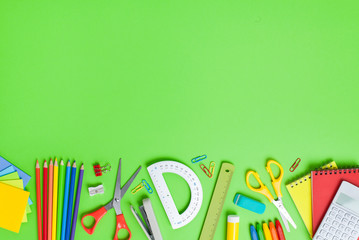 School supplies on green background. Back to school concept. Wall mural