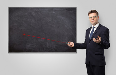 Handsome young teacher with laser pointer teaching
