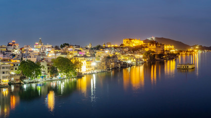 Udaipur city at lake Pichola in the evening, Rajasthan, India. View of City palace reflected on the lake.
