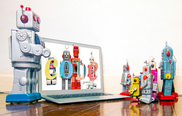 Wall Mural - robot presentation  with laptop