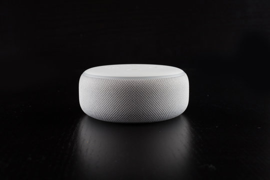 Digital voice assistant with computer and black background