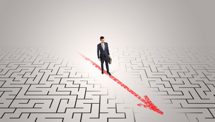 Businessman going through the maze with red arrow