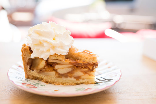 slice of Dutch apple pie with whipped cream.