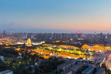 Fotobehang - beautiful xian nightfall cityscape