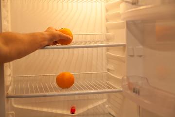Two oranges are in empty fridge