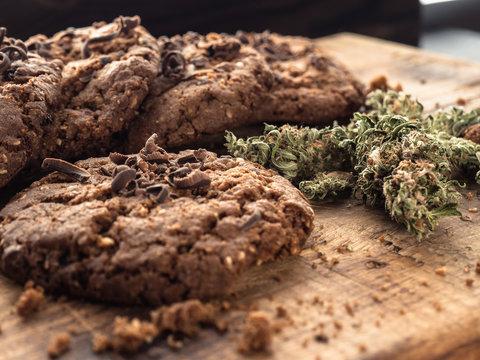 textured chocolate hemp oatmeal cookies on a wooden board