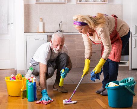 Senior couple doing chores