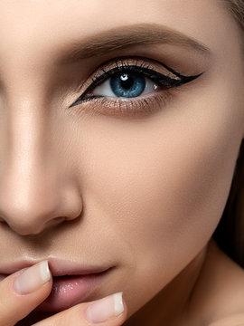 Young beautiful woman with modern fashion makeup