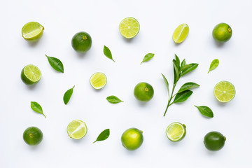Limes with leaves isolated on white background. Wall mural
