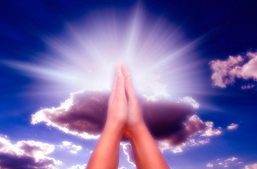 Wall Mural - Christian Catholic Prayer - praying hands with rays of divine light and sky
