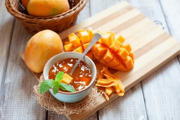 Homemade mango jam on wooden background