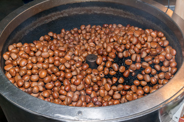 Chestnuts roasted with black gravel in chestnuts roasting machine.